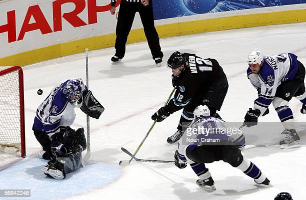 Patrick Marleau of the San Jose Sharks puts a shot on goal against goalie Mathieu Garon Mattias Norstrom and Nathan Dempsey of the Los Angeles Kings...