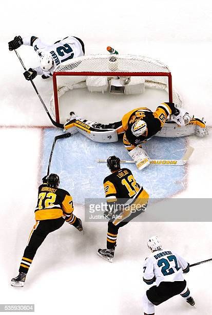 Patrick Marleau of the San Jose Sharks scores a second period goal against Matt Murray of the Pittsburgh Penguins as Patric Hornqvist defends in Game...