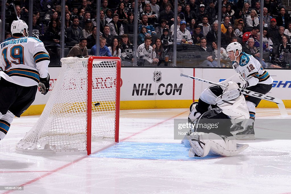 Patrick Marleau #12 of the San Jose Sharks shoots and scores a goal against Jonathan Bernier #45 of the Los Angeles Kings at Staples Center on March 16, 2013 in Los Angeles, California.