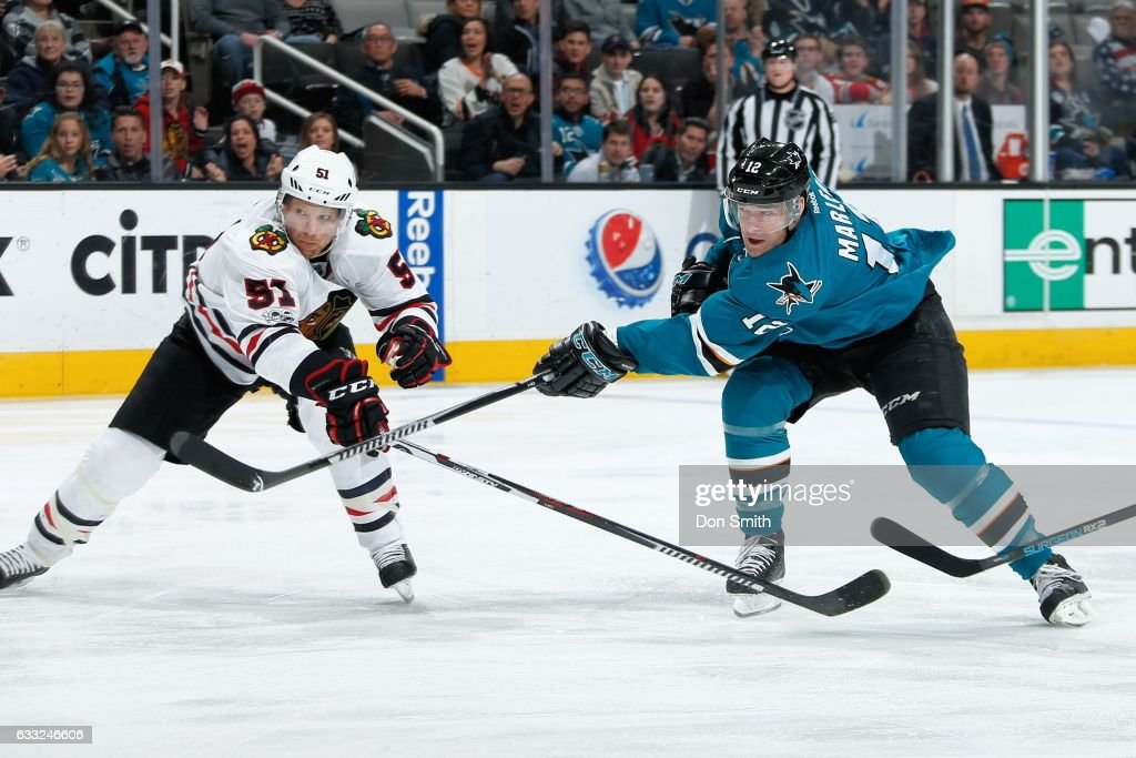 Patrick Marleau #12 of the San Jose Sharks shoots the puck while Brian Campbell #51 of the Chicago Blackhawks defends at SAP Center at San Jose on January 31, 2017 in San Jose, California.