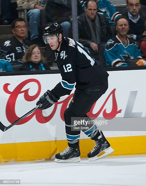 Patrick Marleau of the San Jose Sharks skates after the puck against the Boston Bruins during an NHL game on December 4, 2014 at SAP Center in San...