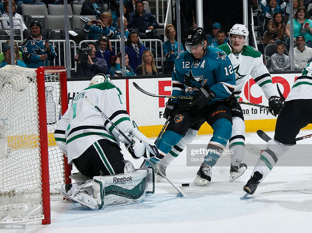 Patrick Marleau #12 of the San Jose Sharks skates in for a rebound shot against Jhonas Enroth #1 and John Klingberg #3 of the Dallas Stars at the SAP Center on April 6, 2015 in San Jose, California .