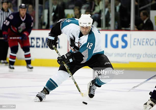 Patrick Marleau of the San Jose Sharks skates the puck through the neutral zone against the Columbus Blue Jackets during their NHL game at Nationwide...