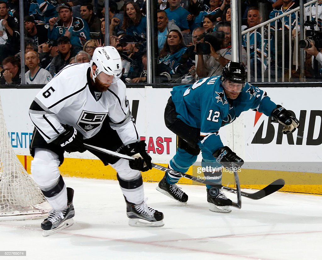 Patrick Marleau #12 of the San Jose Sharks steal the puck by lifting the stick of Jake Muzzin #6 of the Los Angeles Kings during the Western Conference First Round during the 2016 NHL Stanley Cup Playoffs at the SAP Center at San Jose on April 20, 2016 in San Jose, California.