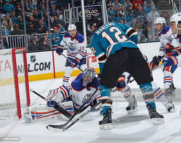 Patrick Marleau of the San Jose Sharks tries to score against Shawn Horcoff Nikolai Khabibulin and Tom Gilbert of the Edmonton Oilers at HP Pavilion...