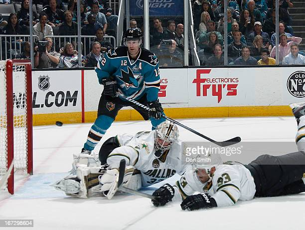 Patrick Marleau of the San Jose Sharks watches as teammate Logan Couture scores a gamewinning goal against Alex Goligoski and Kari Lehtonen of the...