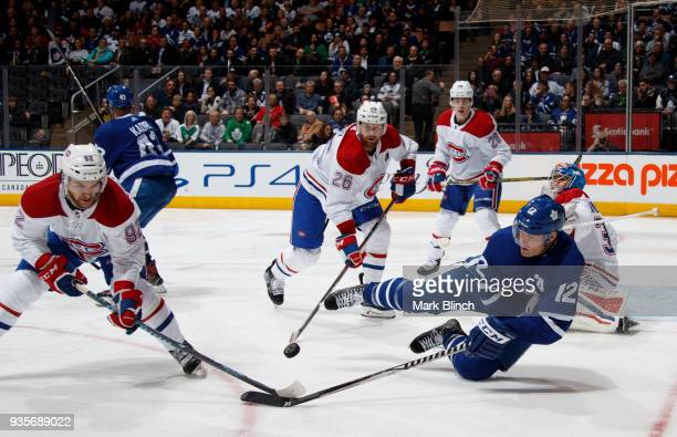 Patrick Marleau of the Toronto Maple Leafs battles for the puck with Jonathan Drouin Jeff Petry Mike Reilly and Charlie Lindgren of the Montreal...