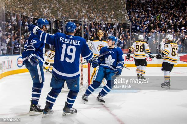 Patrick Marleau of the Toronto Maple Leafs celebrates his goal on Tuukka Rask of the Boston Bruins with teammates Tomas Plekanec and Mitch Marner in...