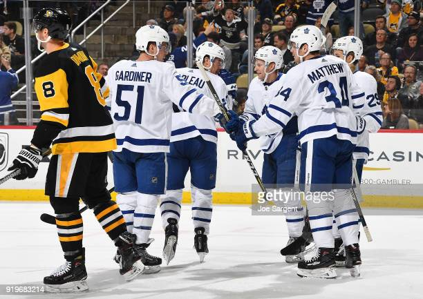 Patrick Marleau of the Toronto Maple Leafs celebrates his goal with teammates in front of Brian Dumoulin of the Pittsburgh Penguins at PPG Paints...