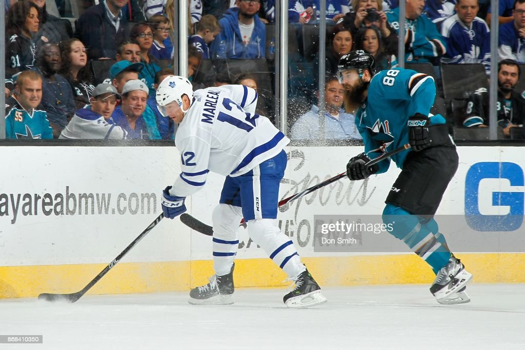 Patrick Marleau #12 of the Toronto Maple Leafs controls the puck ahead of Brent Burns #88 of the San Jose Sharks at SAP Center on October 30, 2017 in San Jose, California.