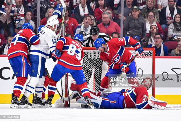 Patrick Marleau of the Toronto Maple Leafs gets the puck past goaltender Carey Price with Ales Hemsky and teammate Jeff Petry of the Montreal...