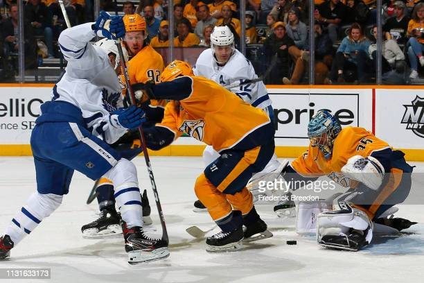Patrick Marleau of the Toronto Maple Leafs watches a puck in front of goalie Pekka Rinne of the Nashville Predators during the second period at...