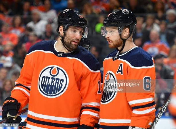 Patrick Maroon and Adam Larsson of the Edmonton Oilers discuss the play during the game against the St Louis Blues on December 21 2017 at Rogers...