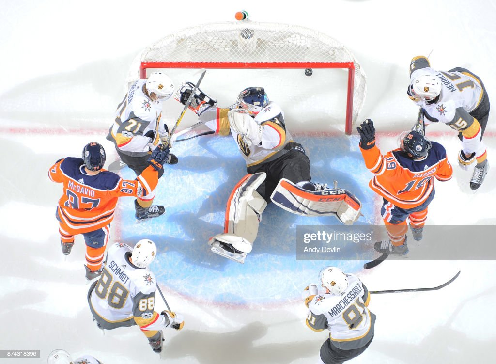 Patrick Maroon #19 and Connor McDavid #97 of the Edmonton Oilers celebrate after scoring a goal on Dylan Ferguson #1 of the Vegas Golden Knights on November 14, 2017 at Rogers Place in Edmonton, Alberta, Canada.