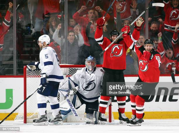 Patrick Maroon and Travis Zajac of the New Jersey Devils celebrate a powerplay goal by Will Butcher against the Tampa Bay Lightning at 404 of the...