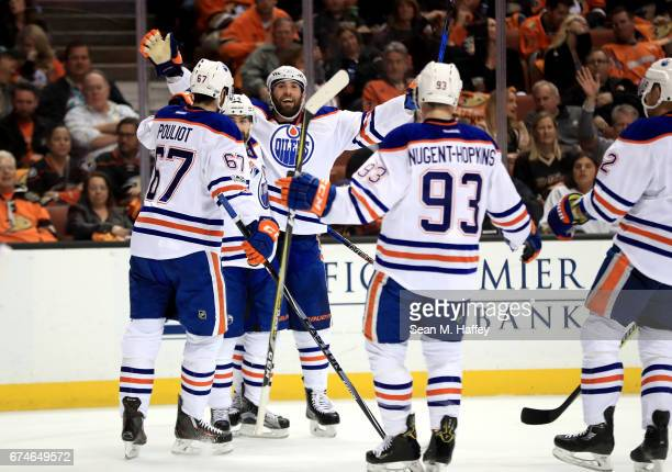 Patrick Maroon is congratulated by Benoit Pouliot and Ryan NugentHopkins of the Edmonton Oilers after scoring a goal during the second period of Game...