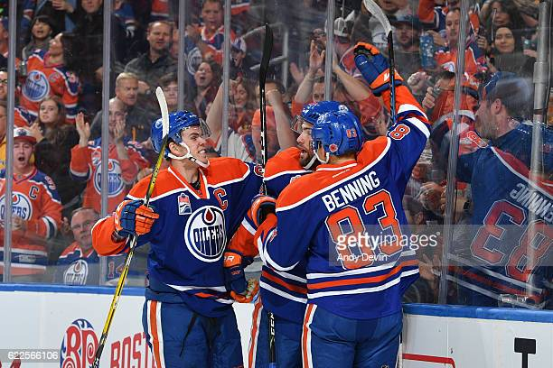 Patrick Maroon Matthew Benning and Connor McDavid of the Edmonton Oilers celebrate after a goal during the game against the Dallas Stars on November...