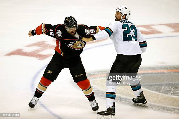 Patrick Maroon of the Anaheim Ducks and Frazer McLaren of the San Jose Sharks fight in the third period of a preseason game at Honda Center on...