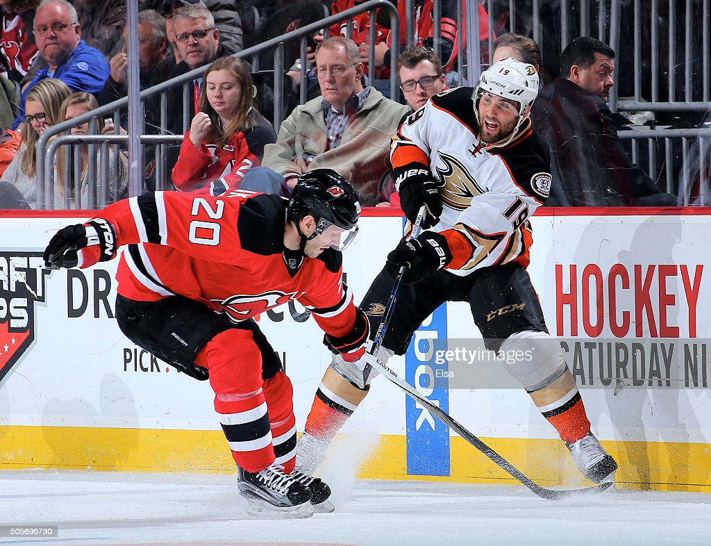 Patrick Maroon #19 of the Anaheim Ducks and Lee Stempniak #20 of the New Jersey Devils fight for the puck on December 19, 2015 at Prudential Center in Newark, New Jersey.The Anaheim Ducks defeated the New Jersey Devils 2-1.