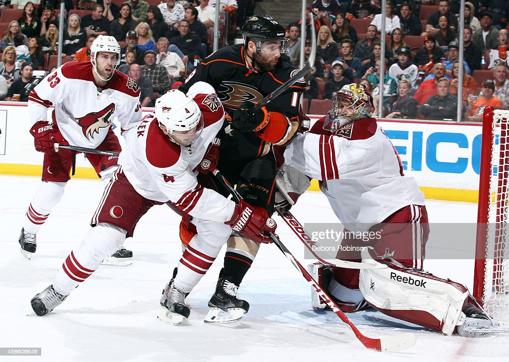 Patrick Maroon #19 of the Anaheim Ducks battles for position against Zbynek Michalek #4 and Mike Smith #41 of the Arizona Coyotes on November 7, 2014 at Honda Center in Anaheim, California.