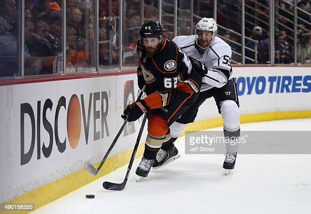 Patrick Maroon of the Anaheim Ducks is pursued by Jeff Schultz of the Los Angeles Kings in Game Five of the Second Round of the 2014 NHL Stanley Cup...