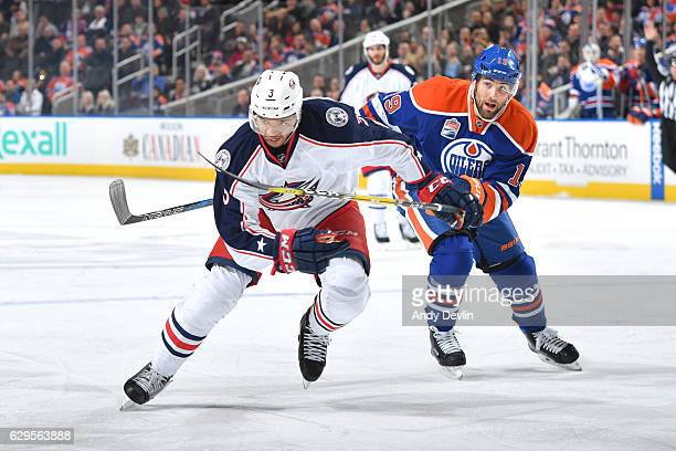 Patrick Maroon of the Edmonton Oilers battles for the puck against Seth Jones of the Columbus Blue Jackets on December 13 2016 at Rogers Place in...