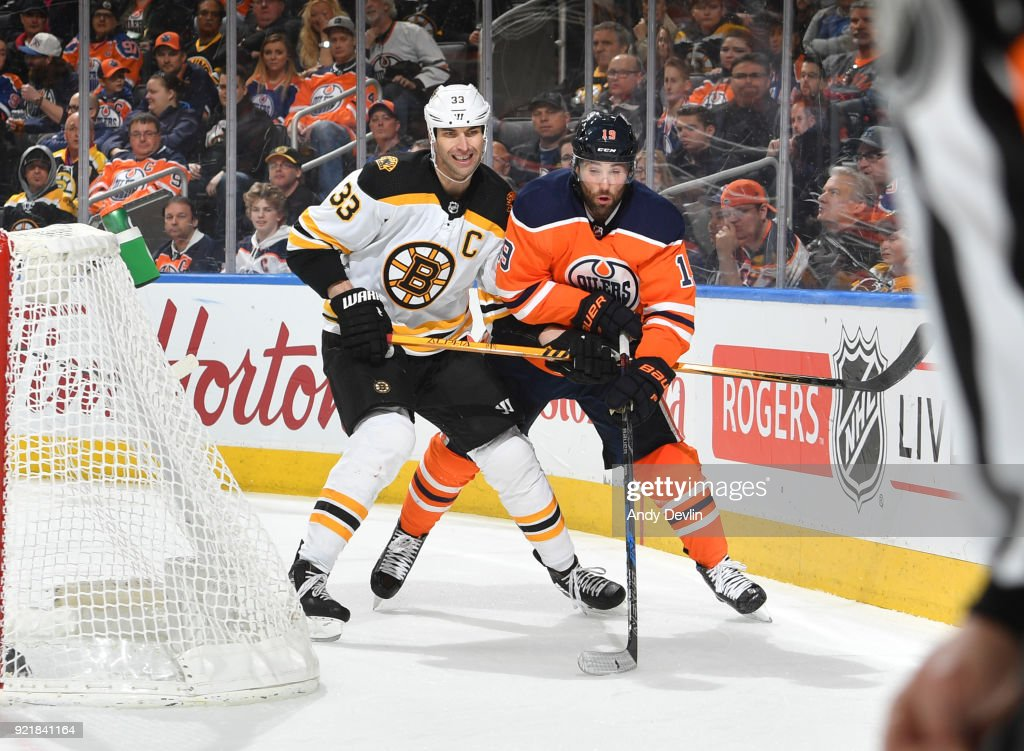 Patrick Maroon #19 of the Edmonton Oilers battles for the puck against Zdeno Chara #33 of the Boston Bruins on February 20, 2018 at Rogers Place in Edmonton, Alberta, Canada.