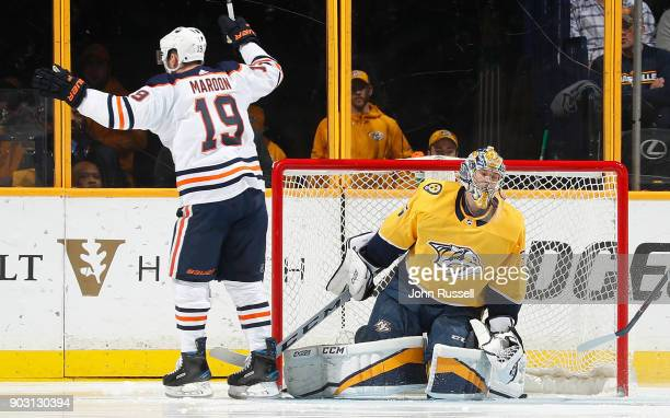 Patrick Maroon of the Edmonton Oilers celebrates a goal by Connor McDavid against Pekka Rinne of the Nashville Predators during an NHL game at...
