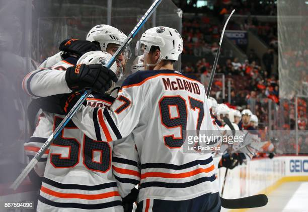 Patrick Maroon of the Edmonton Oilers celebrates his second period goal with teammates Connor McDavid Kailer Yamamoto and Adam Larsson against the...