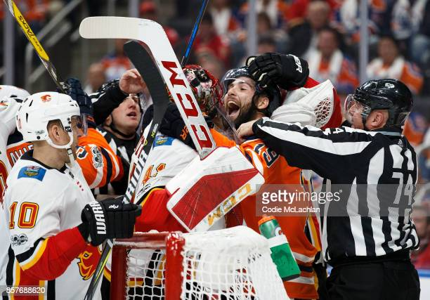 Patrick Maroon of the Edmonton Oilers exchanges words with goaltender Mike Smith of the Calgary Flames at Rogers Place on October 4 2017 in Edmonton...