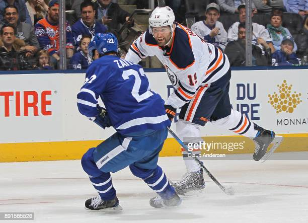 Patrick Maroon of the Edmonton Oilers makes a pass against Nikita Zaitsev of the Toronto Maple Leafs during an NHL game at the Air Canada Centre on...