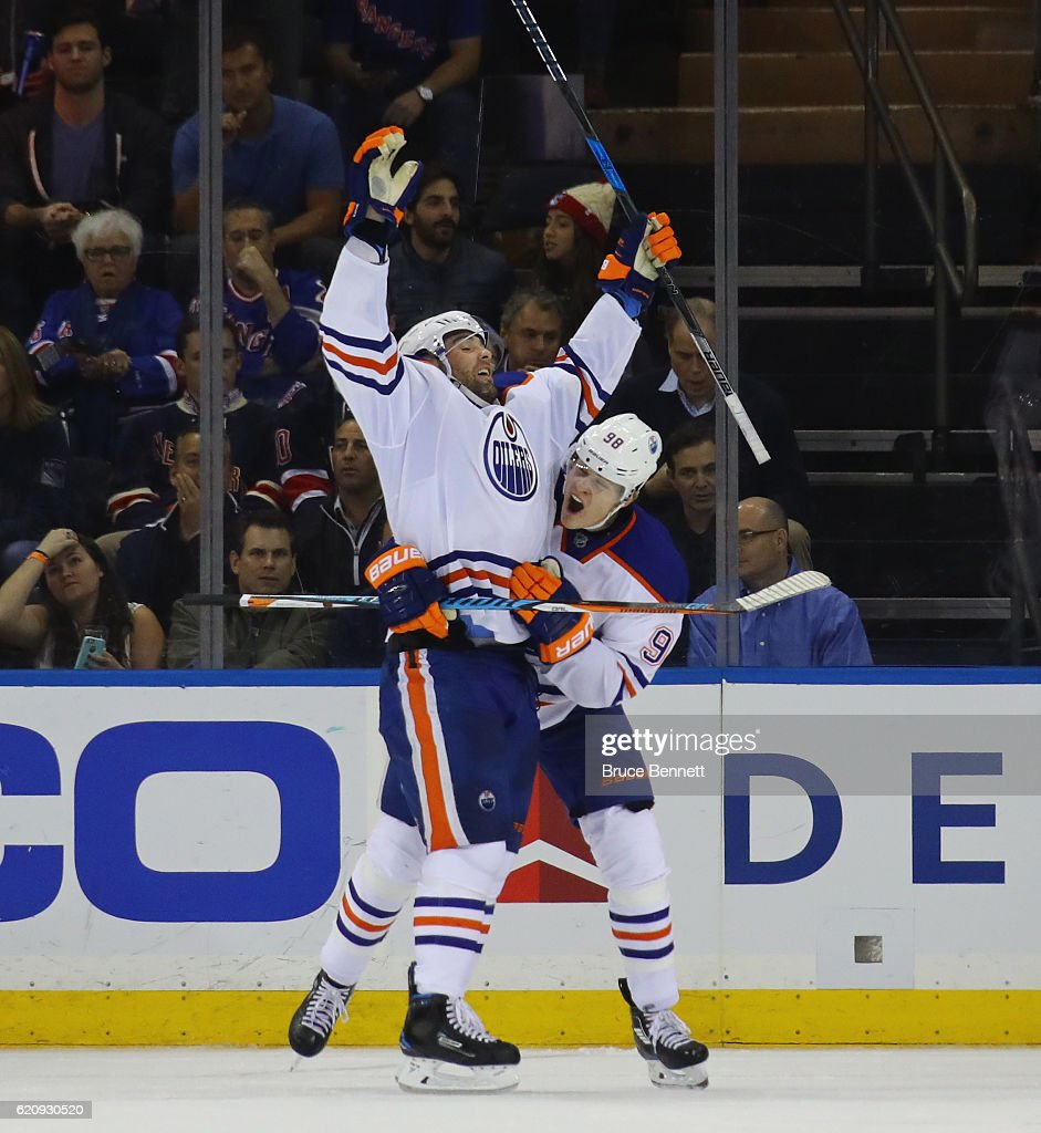 Patrick Maroon #19 of the Edmonton Oilers scores at 10:28 of the second period against the New York Rangers and is grabbed by Jesse Puljujarvi #98 at Madison Square Garden on November 3, 2016 in New York City.