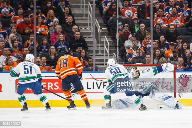 Patrick Maroon of the Edmonton Oilers scores on goaltender Jacob Markstrom of the Vancouver Canucks at Rogers Place on January 20 2018 in Edmonton...