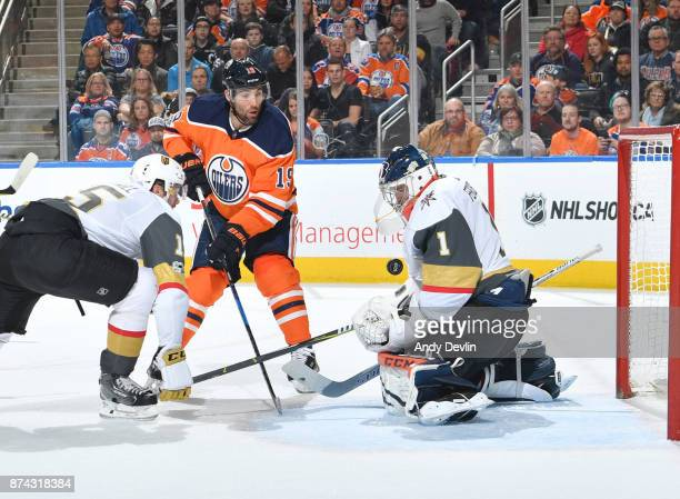 Patrick Maroon of the Edmonton Oilers takes a shot on Dylan Ferguson of the Vegas Golden Knights on November 14 2017 at Rogers Place in Edmonton...