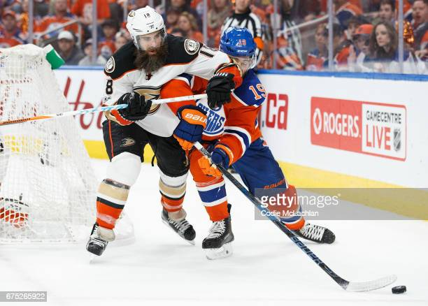 Patrick Maroon of the Edmonton Oilers takes an elbow from Patrick Eaves of the Anaheim Ducks in Game Three of the Western Conference Second Round...