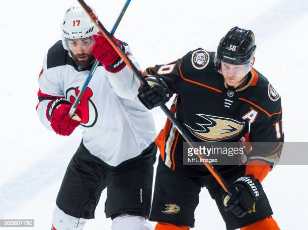 Patrick Maroon of the New Jersey Devils and Corey Perry of the Anaheim Ducks battle for position during the second period of the game at Honda Center...