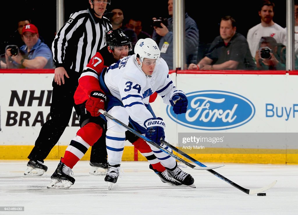 Patrick Maroon #17 of the New Jersey Devils battles for the puck against Auston Matthews #34 of the Toronto Maple Leafs during the game at Prudential Center on April 5, 2018 in Newark, New Jersey.
