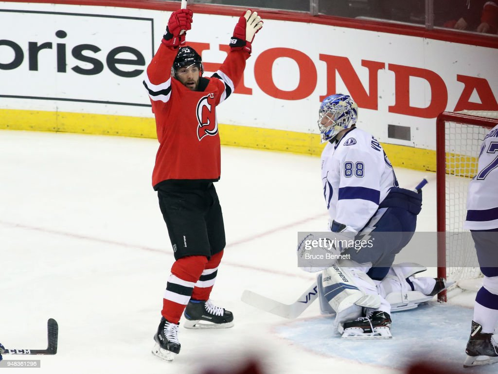 Patrick Maroon #17 of the New Jersey Devils celebrates a first-period goal by Kyle Palmieri #21 against Andrei Vasilevskiy #88 of the Tampa Bay Lightning in Game Four of the Eastern Conference First Round during the 2018 NHL Stanley Cup Playoffs at the Prudential Center on April 18, 2018 in Newark, New Jersey. The Lightning defeated the Devils 3-1.