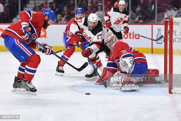 Patrick Maroon of the New Jersey Devils misses a backhand shot against Carey Price of the Montreal Canadiens in the NHL game at the Bell Centre on...