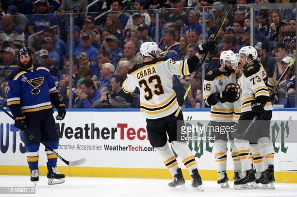 Patrick Maroon of the St Louis Blues looks on as Zdeno Chara of the Boston Bruins looks to celebrate with teammates and David Krejci Karson Kuhlman...