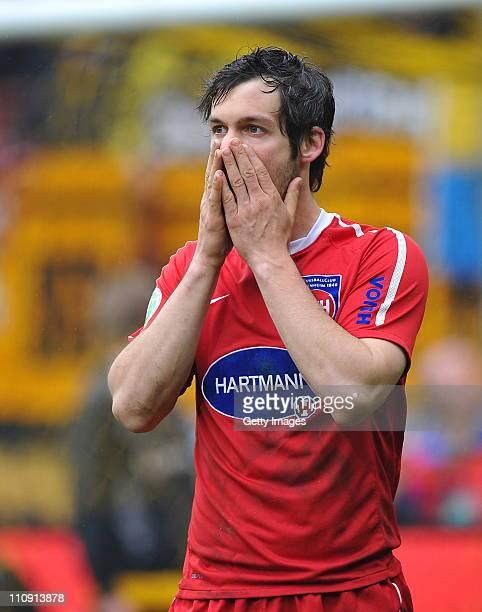 Patrick Mayer of Heidenheim gestures during the Third League match between Dynamo Dresden and 1. FC Heidenheim at the Rudolf Harbig Stadium on March...