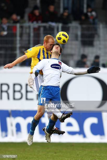 Patrick Mayer of Heidenheim jumps for a header with Marco Riemer of Jena during the Third League match between 1.FC Heidenheim and Carl Zeiss Jena at...