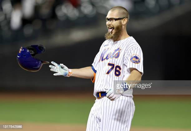 Patrick Mazeika of the New York Mets celebrates after the game winning run was scored on a fielder's choice during his at bat against the Baltimore...