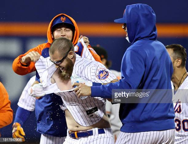 Patrick Mazeika of the New York Mets has his jersey torn after he brought in the game winning run on what was ruled as a fielder's choice in the...