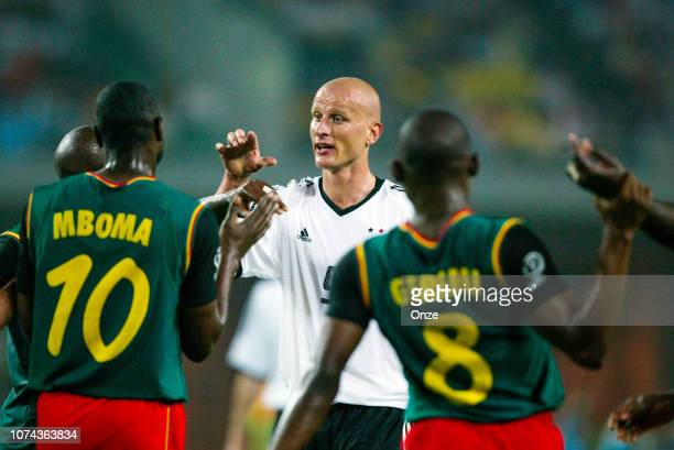 Patrick MBOMA of Cameroon and Carsten JANCKER of Germany during the FIFA World Cup match between Cameroon and Germany on June 11 2002 in Ecopa de...