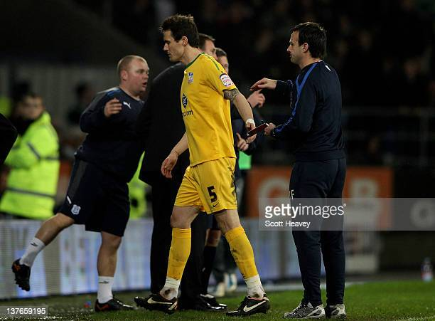 Patrick McCarthy of Crystal Palace is consoled by his manager Dougie Freedman after he is shown the red card by Referee Howard Webb during the...
