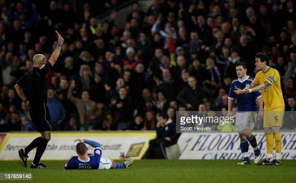 Patrick McCarthy of Crystal Palace is shown the red card by Referee Howard Webb after fouling Kenny Miller of Cardiff City during the Carling Cup...