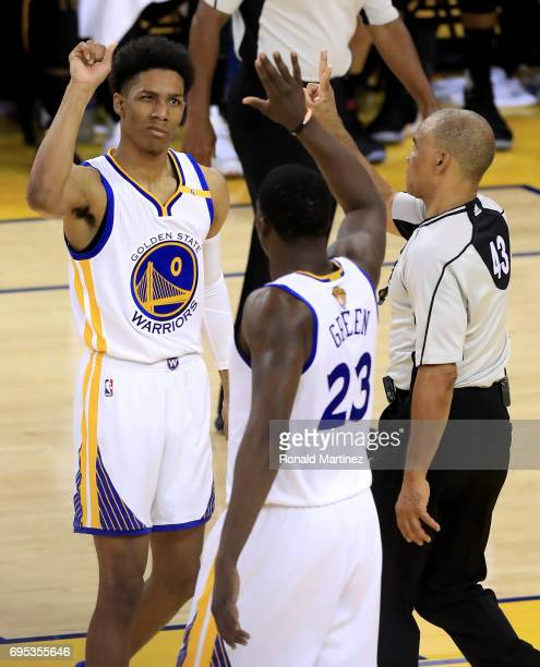 Patrick McCaw and Draymond Green of the Golden State Warriors react to a play against the Cleveland Cavaliers in Game 5 of the 2017 NBA Finals at...