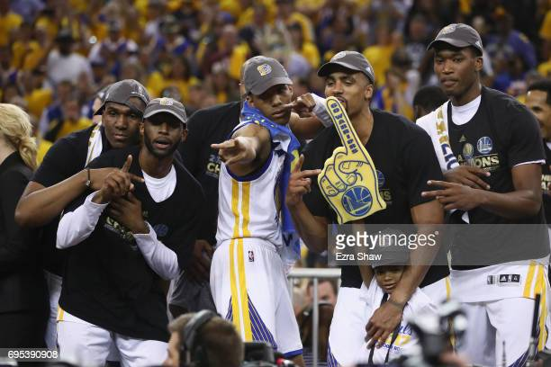 Patrick McCaw and the Golden State Warriors celebrate after defeating the Cleveland Cavaliers 129120 in Game 5 to win the 2017 NBA Finals at ORACLE...