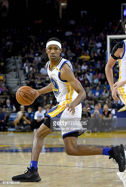 Patrick McCaw of the Golden State Warriors dribbles the ball against the Portland Trail Blazers during an NBA basketball game at ORACLE Arena on...